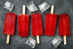 Homemade frozen blood orange natural juice alcoholic popsicles - paletas - ice pops. Overhead, flat lay, top view. Royalty Free Stock Photo