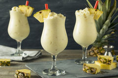 Homemade Frozen Pina Colada Cocktail. With a Pineapple Garnish stock image