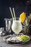 Frozen Pina Colada Cocktail. Homemade frozen Pina Colada cocktail with rum, coconut milk and pineapple garnish over black background Royalty Free Stock Photography