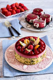 Homemade fruit cake on plate over blue towel Stock Photos