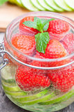 Homemade fruit drink with strawberry lime and mint Royalty Free Stock Image