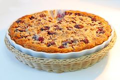 Homemade fruit cake on a white plate and table. Homemade fruit fresh cake with cherries on a white plate and white table stock photos
