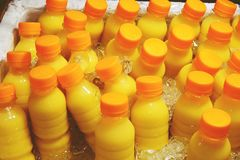 Homemade fruit juice in a plastic bottle on ice.  royalty free stock image
