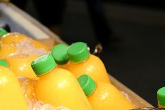 Homemade fruit juice in a plastic bottle on ice.  royalty free stock photography