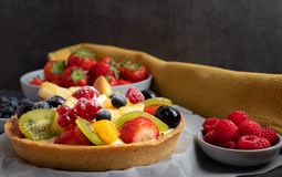 Homemade fruit pie on a rustic grey stone table royalty free stock image