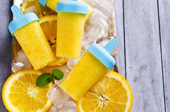 Homemade fruit popsicle. With oranges and mint. Selective focus royalty free stock photography