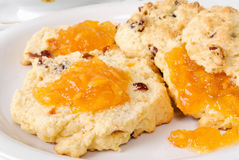 Homemade fruit scones served with Orange Marmalade Preserves Royalty Free Stock Photo
