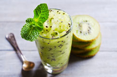 Homemade fruit sorbet. In a glass on a wooden background. Selective focus Royalty Free Stock Photo