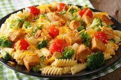 Homemade fusilli Italian pasta with fried pork, broccoli, tomato Stock Photo