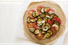 Homemade galette pie with grilled eggplants, tomatoes and onion. Top view Stock Photo