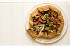 Homemade galette pie with grilled eggplants, tomatoes and onion. Top view Royalty Free Stock Photo