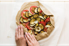 Homemade galette pie with grilled eggplants, tomatoes and onion. Top view Royalty Free Stock Images