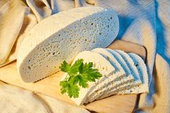 homemade Georgian Imeretian cheese on a wooden Board with fresh parsley royalty free stock image