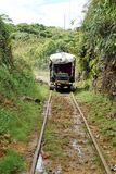 Homemade `ghost train` that run on abandoned railroad tracks. Homemade `ghost train` running through the jungle on abandoned railroad tracks near Alto Tambo Royalty Free Stock Image