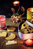 Homemade ginger cookies in heart shaped box with candles Royalty Free Stock Photos