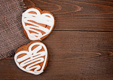 Homemade ginger cookies heart shaped   over wooden table. Royalty Free Stock Image