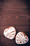 Homemade ginger cookies heart shaped   over wooden table. Stock Photo
