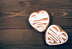 Homemade ginger cookies heart shaped   over wooden table. Stock Photography