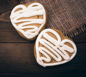 Homemade ginger cookies heart shaped   over wooden table. Royalty Free Stock Photos