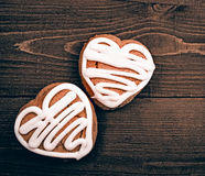Homemade ginger cookies heart shaped   over wooden table. Royalty Free Stock Images