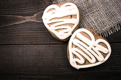 Homemade ginger cookies heart shaped   over wooden table. Stock Images