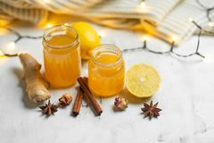 Homemade ginger and lemon jam on a light background, close-up. Natural products to support the immune system in the winter. Phytotherapy. Healthy food, health royalty free stock images