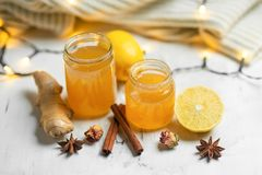 Homemade ginger and lemon jam on a light background, close-up. Natural products to support the immune system in the winter. Phytotherapy. Healthy food, health stock photo