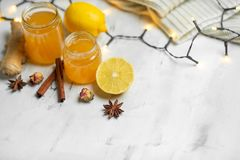 Homemade ginger and lemon jam on a light background, close-up. Natural products to support the immune system in the winter. Phytotherapy. Healthy food, health stock photography
