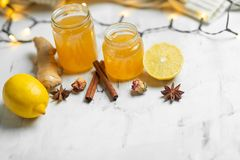 Homemade ginger and lemon jam on a light background, close-up. Natural products to support the immune system in the winter. Phytotherapy. Healthy food, health royalty free stock photography
