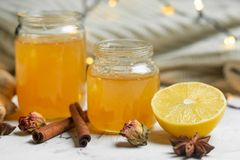 Homemade ginger and lemon jam on a light background, close-up. Natural products to support the immune system in the winter. Phytotherapy. Healthy food, health royalty free stock photos
