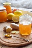 Homemade ginger and lemon jam on wooden background. Natural products to support the immune system in winter. Herbal medicine, heal. Thy food Stock Photos