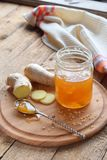 Homemade ginger and lemon jam on wooden background. Natural products to support the immune system in winter. Herbal medicine, heal. Thy food Stock Image