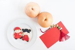 Homemade gingerbread as Chinese boy and girl dolls in the white Royalty Free Stock Images