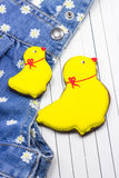 Homemade gingerbread chickens and jeans. On a white background royalty free stock photo