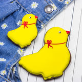 Homemade gingerbread chickens and jeans Stock Photos