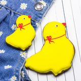 Homemade gingerbread chickens and jeans Royalty Free Stock Images