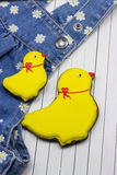 Homemade gingerbread chickens and jeans. On a white background royalty free stock photos