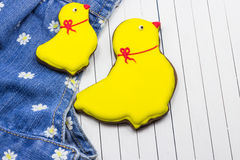 Homemade gingerbread chickens and jeans. On a white wooden background stock photo