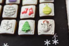 Homemade gingerbread christmas cookies advent calendar on black background royalty free stock photo
