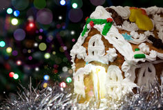 Homemade gingerbread Christmas house with night colorful bokeh Stock Images