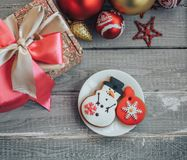Homemade Gingerbread Cookie in the form of a snowman and Christmas toy Stock Photo