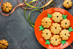 Homemade gingerbread cookie for Halloween or Thanksgiving. Pumpkin cookies for kids on orange plate. Blank space for text, top view stock photography