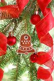 Homemade gingerbread cookie hanging on christmas tree Stock Photography