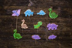 Homemade gingerbread cookies as funny dinosaurs stock photos