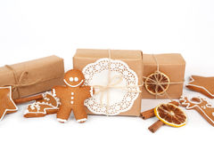 Homemade gingerbread cookies with icing decoration and present boxes Stock Photos