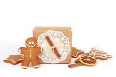 Homemade gingerbread cookies with icing decoration and present boxes Stock Photography