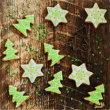 Homemade gingerbread cookies with icing on wooden background Royalty Free Stock Image