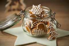 Homemade gingerbread in a glass jar. On a wooden table. Christmas biscuits stock photography
