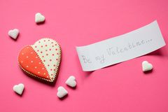 Homemade gingerbread hearts and paper with text be my Valentine. Cookies hearts on pink background. Edible Valentines Day Gift o. R greeting card concept royalty free stock photo