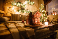 Homemade gingerbread house on background room decorated for Christmas. Stock Photos